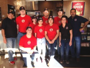 Franchisee Manuel Pizaño-Carlo (far right) poses with his team in front of the counter at the 100th Erbert & Gerbert's location.
